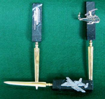 Letter Opener with assorted pins and badges