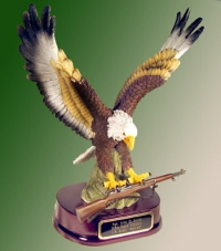 Flying Eagle holding an M 1 Garand Rifle