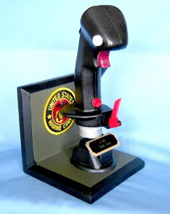 Modern stick grip on wood base with U.S.M.C. Patch
