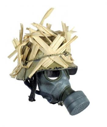 German helmet with grass camo and gas mask