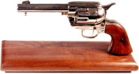 Western style Colt Peacemaker 1873 on wood