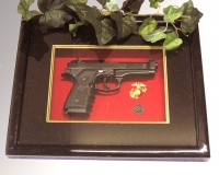 Pistol in shadow box w/glass cover
