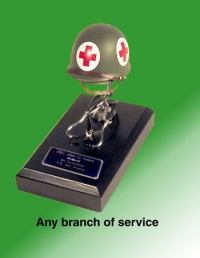 Medic helmet with stethescope on black alum base
