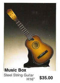 "miniature Steel String Guitar ( music box ) 16"" high"