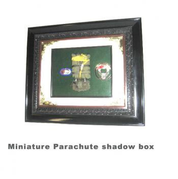 miniature parachute in shadow box