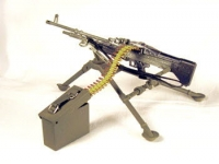U.S. M-60 machine gun on stand with ammo can