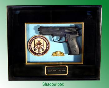 Shadow box with gun
