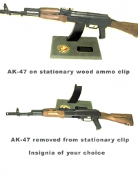 AK-47 rifle on wood base
