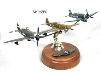 3 ww2 airplanes flying in formation on stand