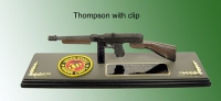 Thompson sub machine gun on wood plaque base