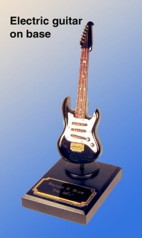 miniature Guitar as a paper weight