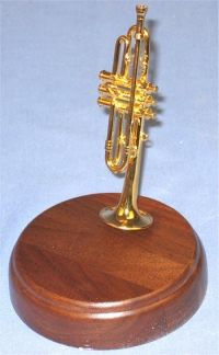miniature trumpet on rd wood base