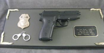 Police award gun plaque--