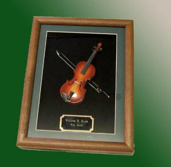 miniature Violin mounted in a shadow box