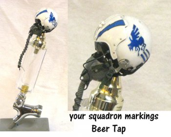 U.S. Pilot with squadron logo on helmet as beer tap