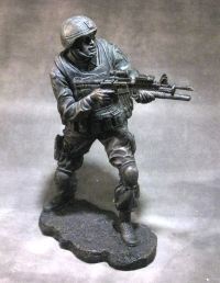 statue of soldier standing no base