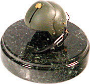 Helicopter pilot helmet on round marble base