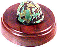 Marine camo helmet on round walnut wood base