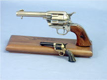 Western style pistol mounted on walnut wood
