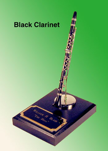 miniature Black Clarinet on heavy base (paper wt. )